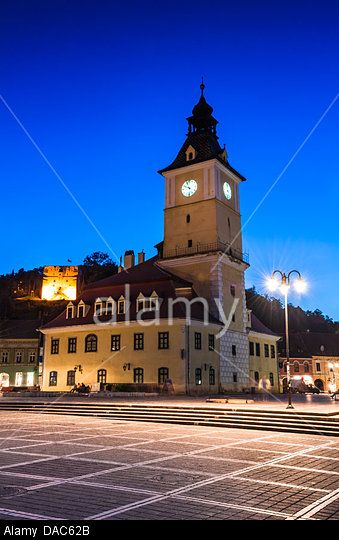 Council House, city center of Brasov at twilight. Medieval saxon architecture in Transylvania.