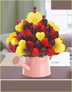 Edible Arrangements. Cute, yummy and somewhat healthy. kinda pricy though $81 for this specific arrangement.
