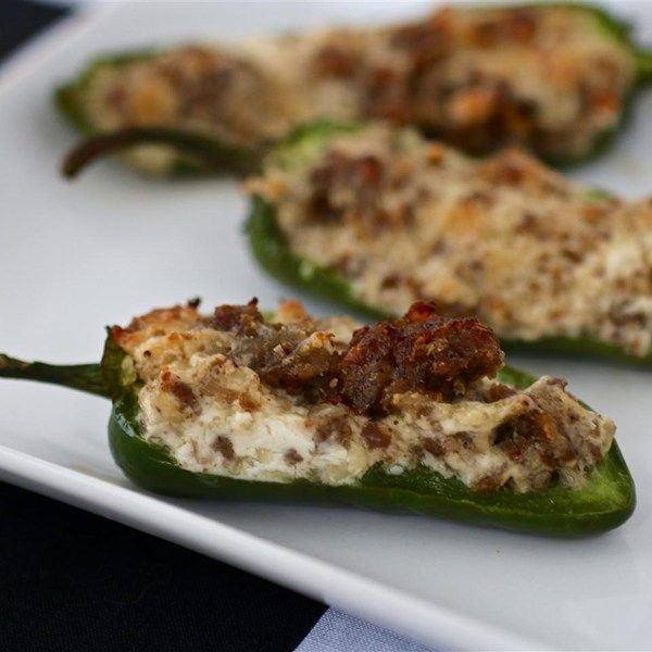 """Sausage Stuffed Jalapenos   """"Exellent flavor! I tried 3 different cheeses, blue fcheese in some, cheddar in some and asaigo in most, and then wrapped in half slice of bacon. """""""