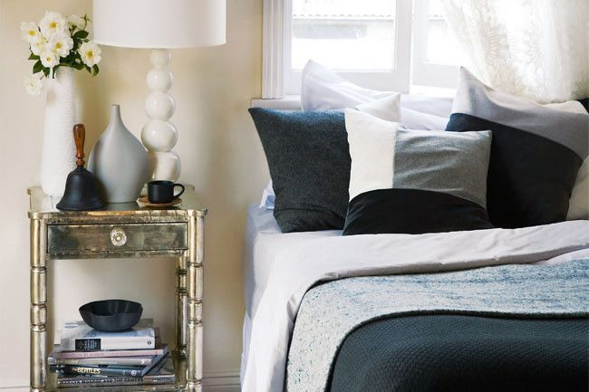 Beautiful bedding setting with multiple layers.