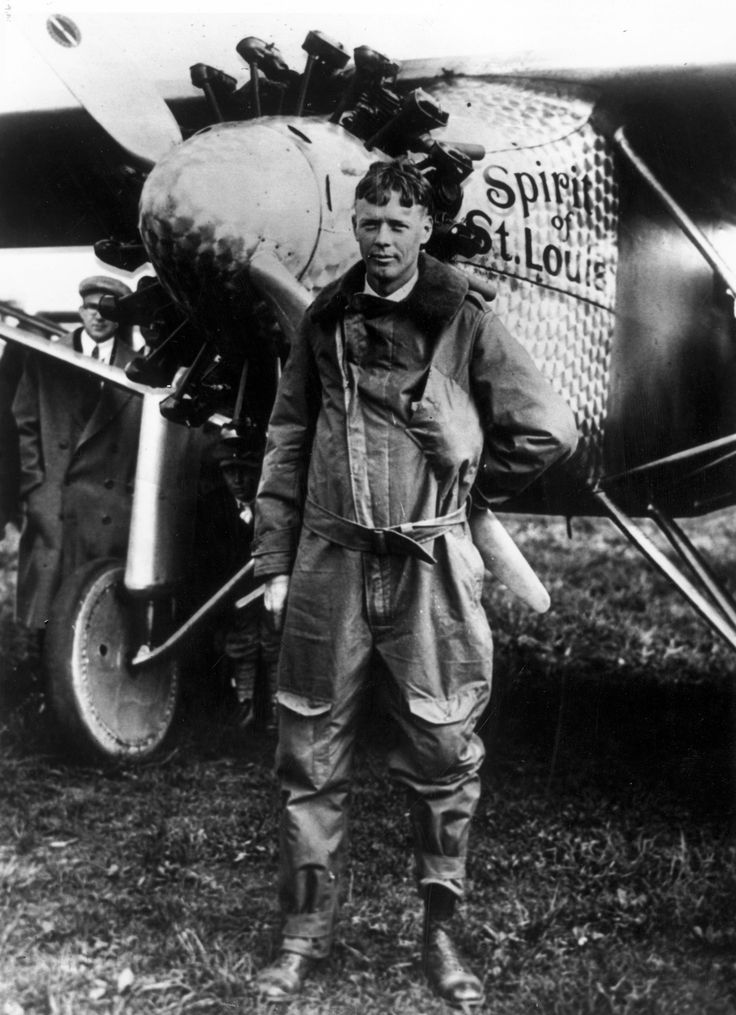 American aviator, engineer and Pulitzer Prize winner Charles Lindbergh (1902- 1974) poses with the 'Spirit of St Louis,' the plane he used to make the first non-stop solo flight across the Atlantic, May 1927.