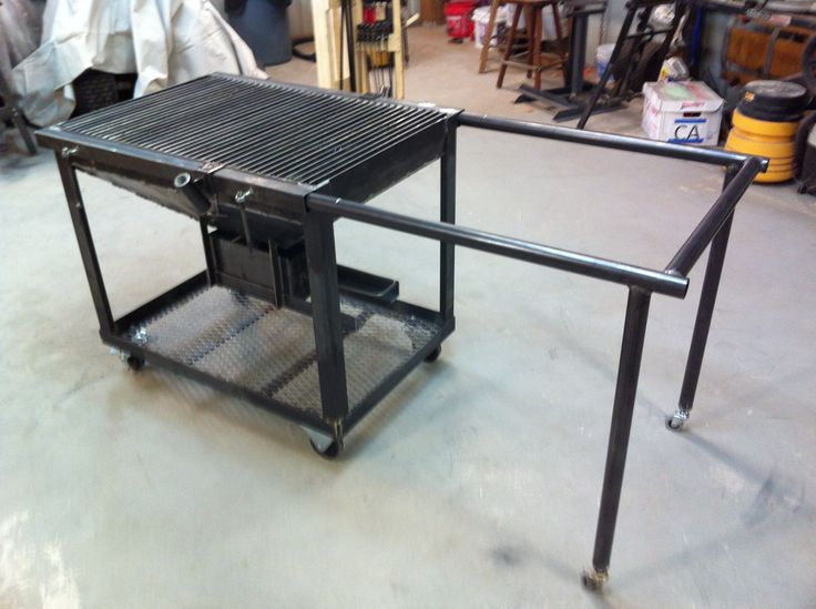 Plasma cutting table with dross catching drawer and extendable work surface.