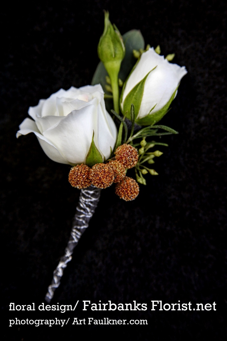 white spray rose boutonniere with Brezillia Berry and seeded eucalyptus accent and silver wire wrap by Lana with Fairbanks Florist.  Photo by Art Faulkner.com