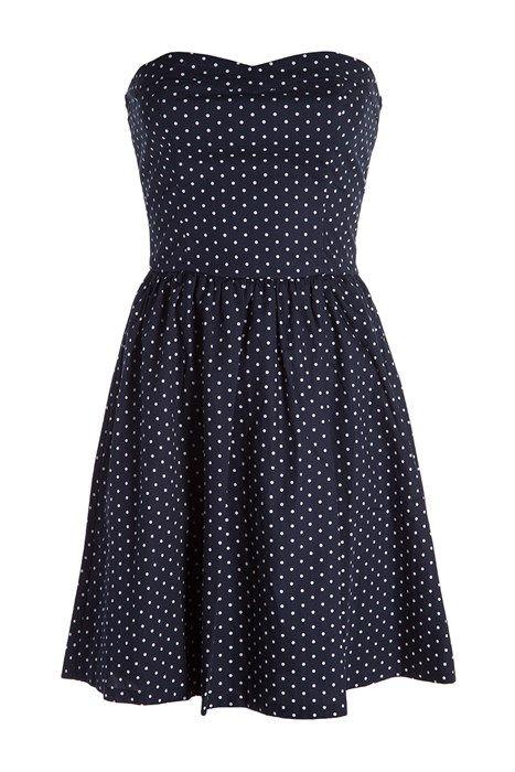 Délicieusement rétro, cette robe vous séduira avec son imprimé pois. Robe bustier, décolleté coeur. Surpiqûres sur le haut de la robe. Plis creux donnant du mouvement à la jupe. Coloris uni, pois contrastés sur l'ensemble.