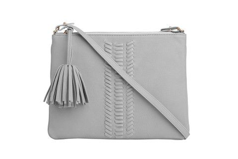 Crossbody Editors Pouch  WHIPSTITCH in grey. Thoughtfully designed for all your needs, this minimalist flat bag features a clean  look and whipstitch detailing. Sling it crossbody or tuck this versatile style under your arm like a clutch.