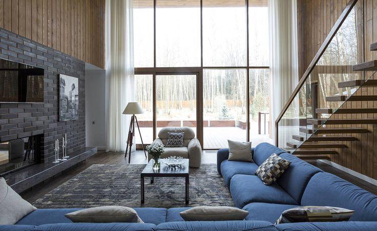 ДОМ В ПОСЕЛКЕ ПОЛИВАНОВО : Salas de estar escandinavas por Aleksandr Zhydkov architect