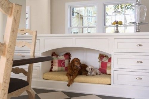 This dog bed nook is such swell idea. Our furry pals always want to hang out in the kitchen with us, so it makes  a lot of sense to provide a way to keep them comfortable yet out of the way.  Although, based on my experiences with pet doors, you might find a toddler cuddling up there, too!