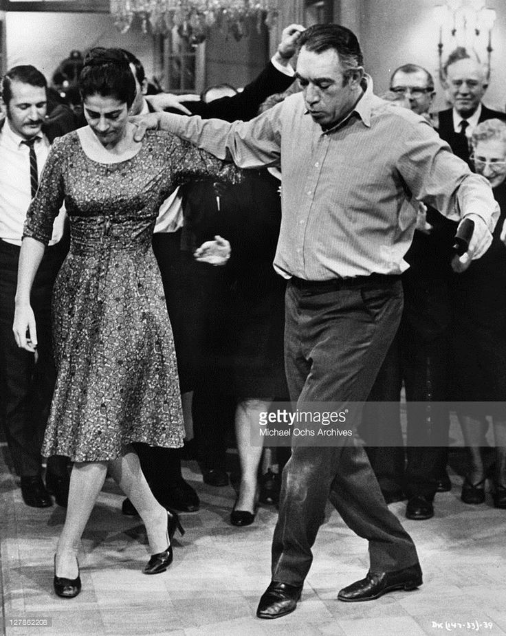 Irene Papas and Anthony Quinn join in a traditional joyful Greek dance in a scene from the film 'A Dream of Kings', 1969.