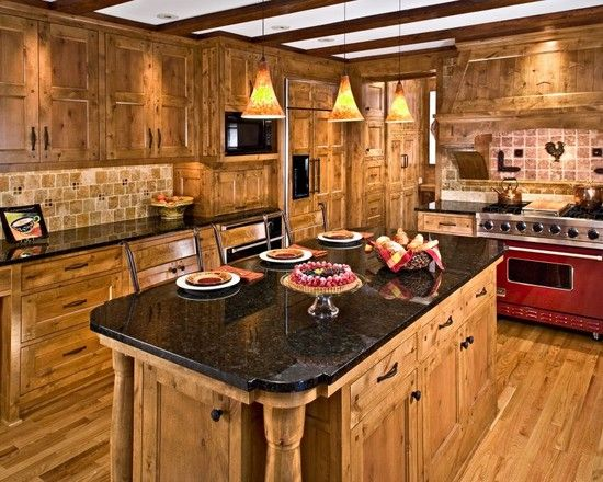 Traditional Kitchen With Knotty Pine Cabinets / Black Granite Countertop /  Light Brown Tile Back