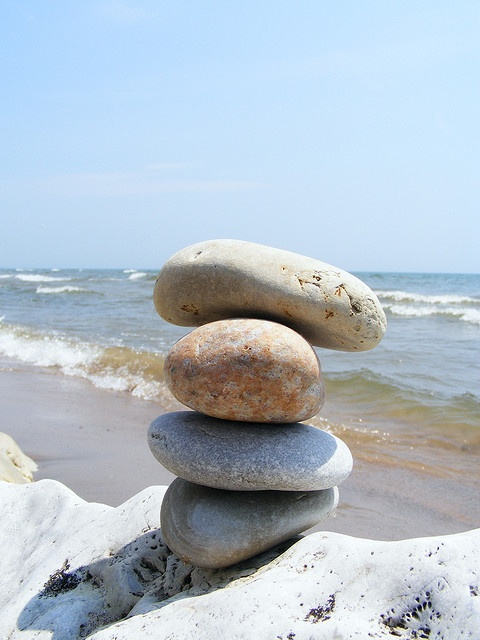 balancing stones at the beach