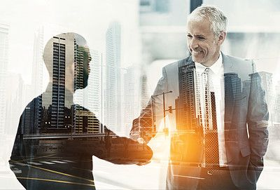 Multiple exposure shot of two businesspeople shaking hands superimposed on a cityscape - stock photo #1367796