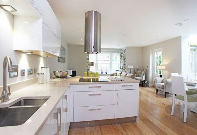 White And Grey Kitchen With Warm Wooden Floors Home