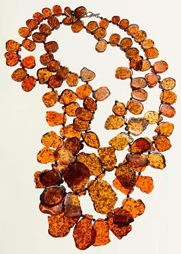 "necklace of Amber...""Lithuanian Gold""--amber is important in Lithuanian culture, being the national stone and a traditional status symbol--amongst Lithuanian women, it could almost be said that she who dies with the most amber wins ;P"
