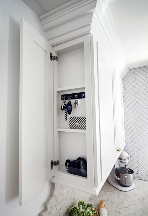This strategically placed micro cabinet provides a spot for homeowners to drop their keys and mail on the way in.