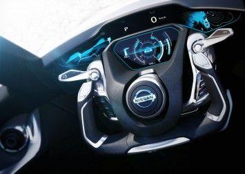Nissan BladeGlider Concept Interior - Steering Wheel futuristic digital gauges blue information chrome black multifunction dynamic