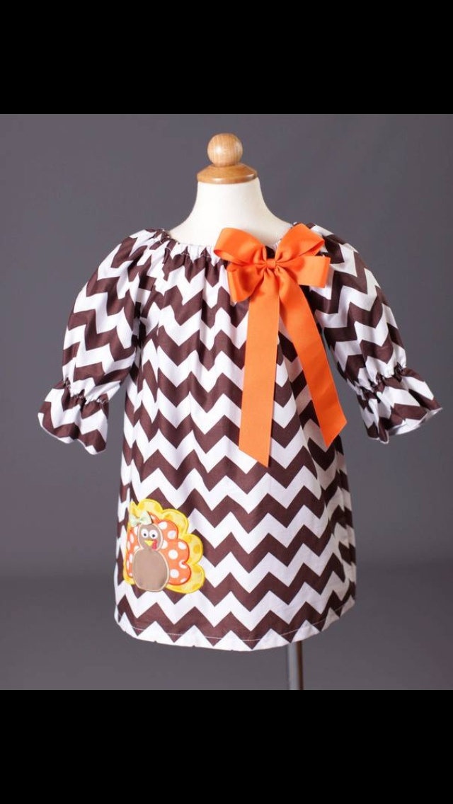 The girls fall dresses are like this except it's a pumpkin with there initial