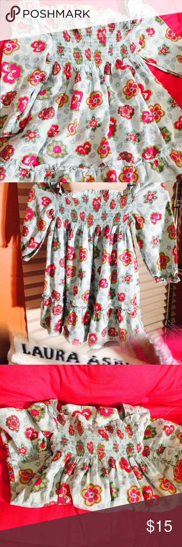 Laura Ashley dress New without tags lil girl size 5 Laura Ashley dress smock bodice, long sleeve turquoise with pink flowers 🌺 i wish they made it in my size really cute summer easter dress (Shop and feel good about it 😁. Part of the money u spend goes to Purple Heart Foundation 💜) Laura Ashley Dresses Casual
