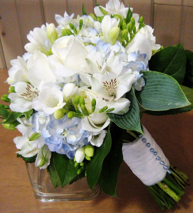 Bridal Bouquet with blue hydrangea, white freesia, alstroemeria and import roses. JG- I really the hint of blue in it and the light green.  is this possible with the flowers we talked about?