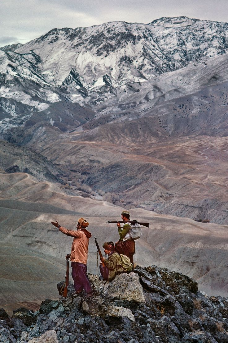 Steve McCurry's Afghanistan – in pictures: Mujahideen stand atop the Hindu Kush mountains, 1984.