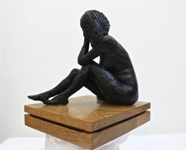 Painted polished plaster on oak #sculpture by #sculptor Eva Humphrey-Lahti titled: 'Black Sitting nude (Naked Resting Thinking statue)'. #EvaHumphreyLahti