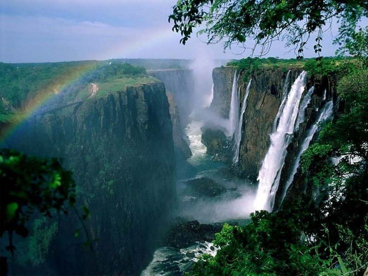 The Victoria Waterfalls | Border Between Zimbabwe and Zambia: Zimbabwe, Vacations Destinations, Natural Wonder, Southafrica, Waterfalls, South Africa, Rainbows, Victoria Fall, Angel Fall