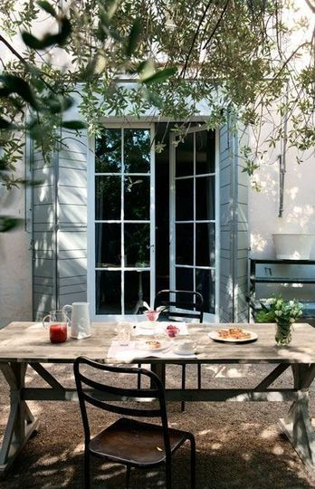 """shutters? gives the back a """"french provincial"""" look...a long easily built table with mismatched chairs for a get-together..."""