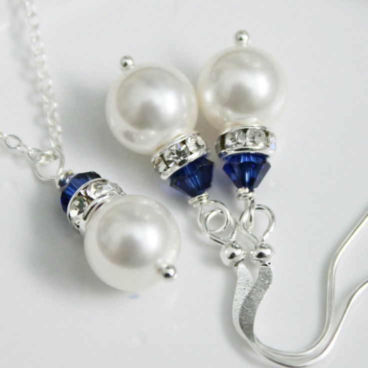 6 Bridesmaid Jewelry Sets - Swarovski White Pearl and Dark Sapphire or Navy Blue Crystal Necklace and Earring Set. $84.00, via Etsy.
