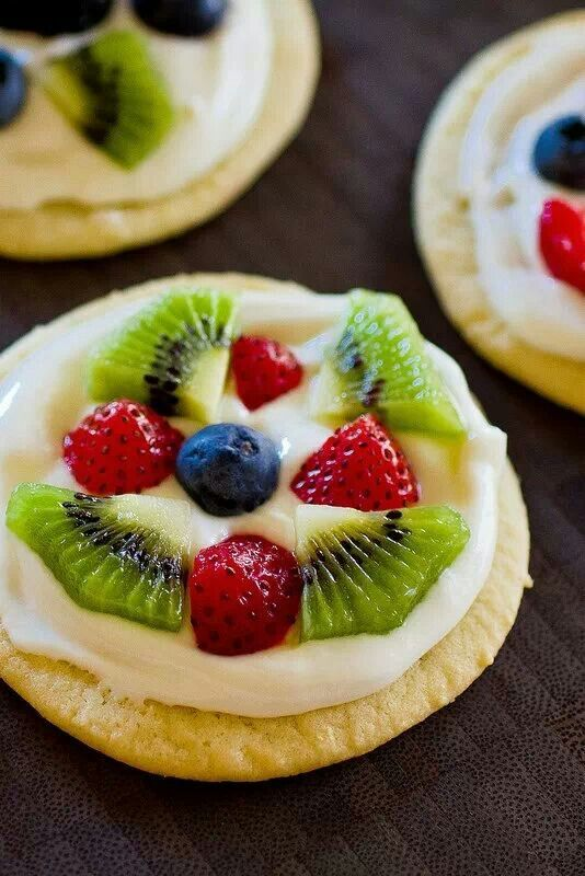 MINI FRUIT PIZZAS: Sugar Cookies, topped with 8oz Cream Cheese mixed with 1 jar of Marshmallow Creme. Fresh Fruit added...