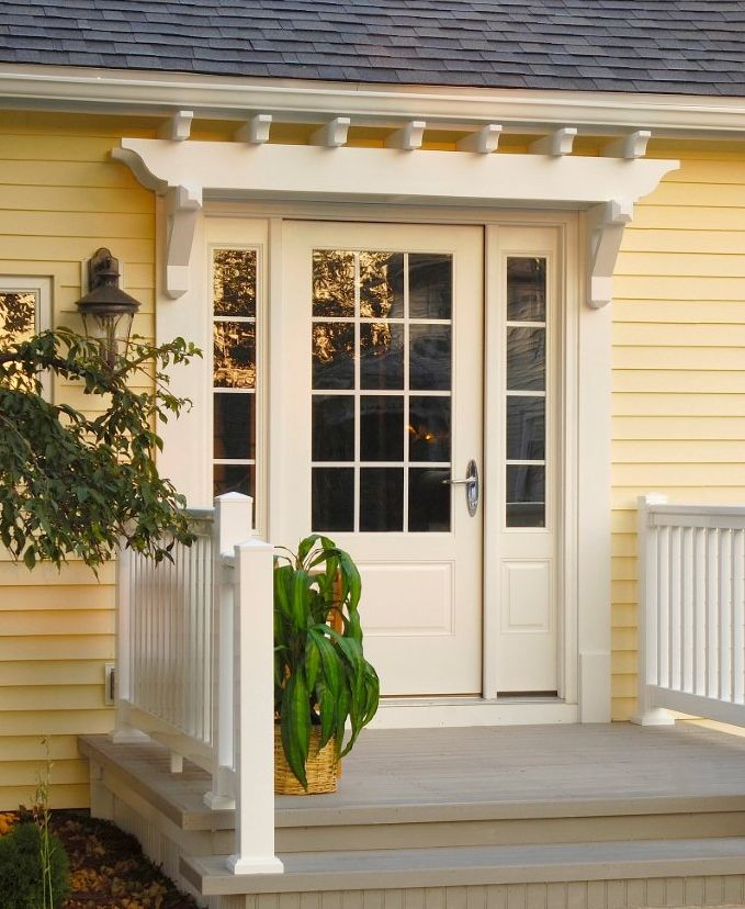 Fypon PVC Trellis System Over Entry Door - this looks awesome! It adds detail over the door, it's basically maintenance-free & it's much less expensive than having a contractor frame & shingle an overhang.