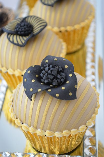 Chocolate sponge with caramel filling. Unique gold and black cupcakes