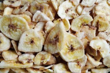 Make your own banana chips, easy and healthy snack. Cute them into 1/4 inch slices and arrange them on a lightly greased cookie sheet and sprinkle with lemon juice. Put them in a 150 degree oven for 1 - 1 1/2 hours until completely dehydrated. ENJOY