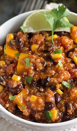 """This crockpot Mexican quinoa is bursting with deliciously fresh and healthy ingredients. This dish is all cooked in the slow cooker (even the quinoa and butternut squash) and has lots of """"hidden veggies."""""""
