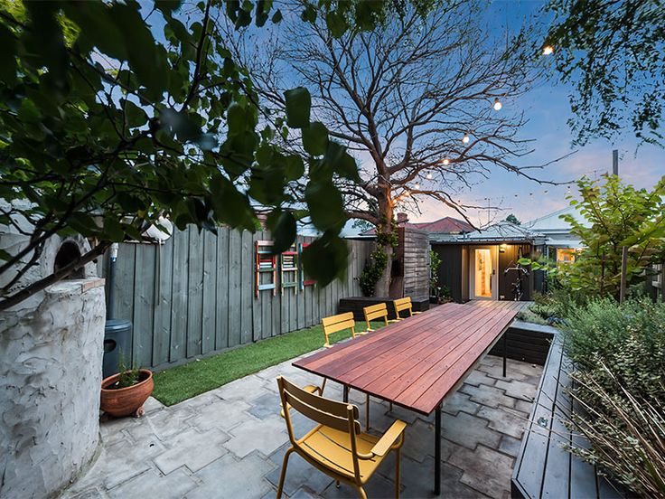 Discover a magical courtyard with a prized magnolia tree at 22 Simpson Street, Yarraville. #Yarraville