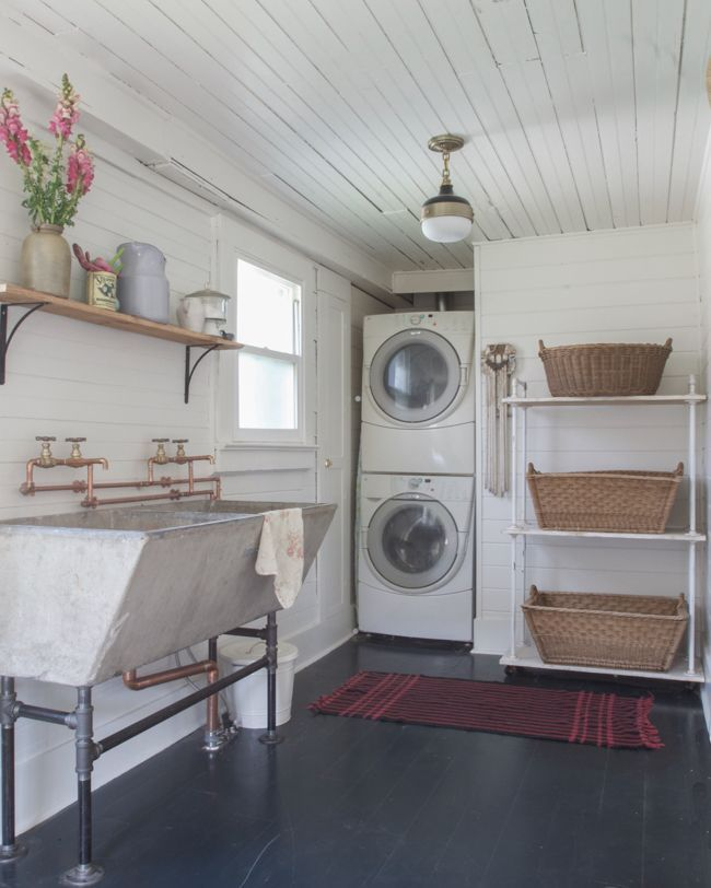 Great space - love the practical tubs. Darling light fixture. Definitely NOT the stacked appliances (maintenance??).