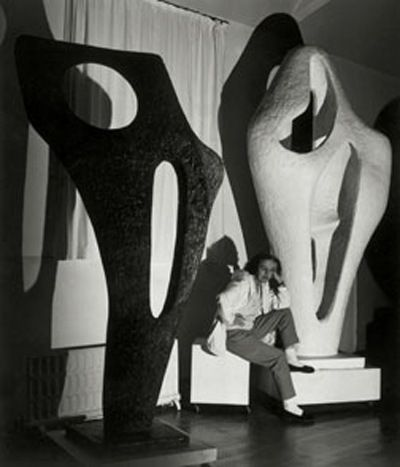 Hepworth with two of her works, November 1964 Photo: Lucien Myers