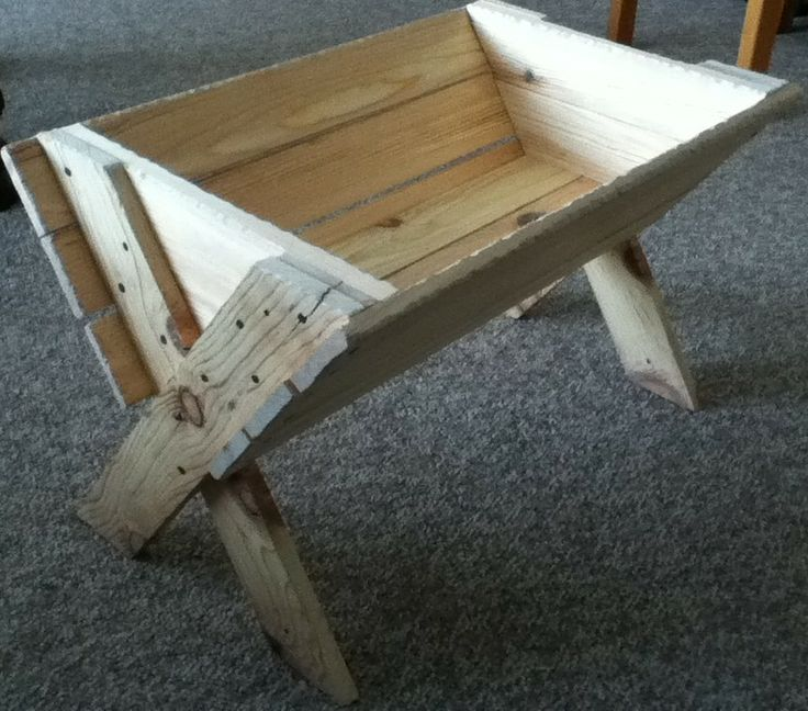 Rustic manger for a life-size Nativity scene.