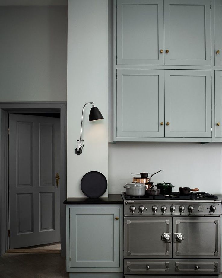 French gray cabinetry lends old-world feel