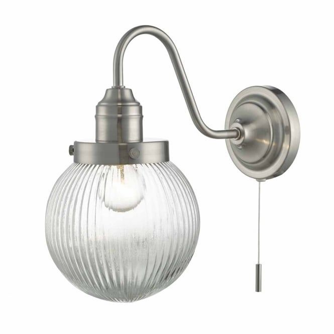 A vintage style single wall light in a satin nickel finish with a clear ribbed glass globe shade. This would be great for lighting in an industrial setting and ideal for kitchen lighting. This light is double insulated for safe use without need of an earth wire. This light is individually switched by a pull cord.
