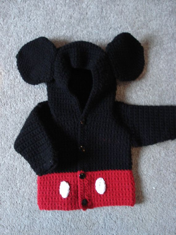 "Mickey Mouse crochet pattern This crochet pattern contains10 page, with written instruction and photos. It uses Worsted weight yarn (#4). 6.5mm (size k) and 4mm(sizeG)crochet hook, or hook size needed to obtaine gauge.This PATTERN IS FOR SIZE 12 months. it measures 22"" around chest and is 12"" long when completed in proper gauge."