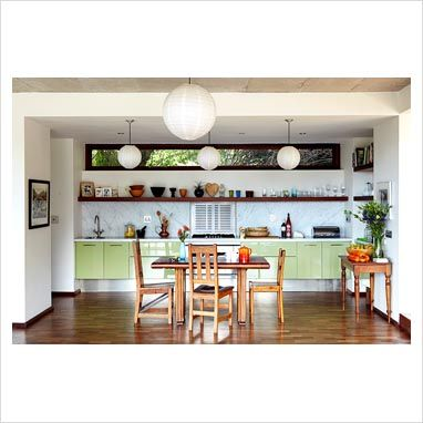 I love the kitchen of Peter Cohen and Genevieve Hofmeyr. Minimalistic, yet cosy.