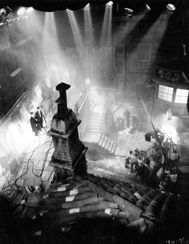 """Here's Hollywood movie making at its finest, if you ask me. This shot is of a circa 1880s London street set built for Paramount Pictures' 1931 production of """"Dr. Jekyll and Mr. Hyde."""" I love how the key lights cut through the fog they've filled the soundstage with in order to recreate misty Victorian London. (And of course the dramatic camera angle doesn't hurt, either.)"""