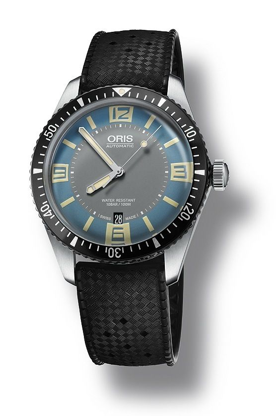 The recently released blue-and-gray-dialed version of the @oris Diver Sixty-Five (Ref. 733 7707 406) is powered by an automatic Sellita SW200 movement and comes with 40-mm-diameter case that is water-resistant to 100 meters. More information at: http://www.watchtime.com/wristwatch-industry-news/watches/dive-watch-news-oris-launches-a-new-version-of-its-sixty-five-diver/ #oris #watchtime #divewatch