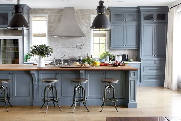 Kitchen Dreams. Grey blue cabinets and an island with a butcher block wood countertop. Interior Designer: Lucas Studio