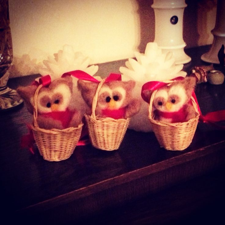 Three little needle felted owls in baskets.