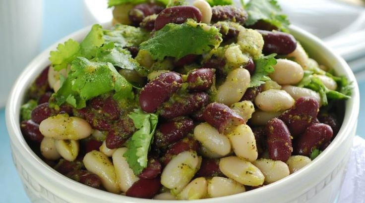 Bean salad with orange dressing   Ingredients: 1 can (400 grams) of red beans 1 can (420 grams) of white lima beans Medium bunch of coriander For refueling: 1 orange 1 clove of garlic Small bunch of green onions 4 tablespoons of olive oil On a pinch of dried oregano and basil Salt, freshly ground …