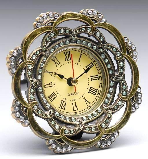 clock inside a broach