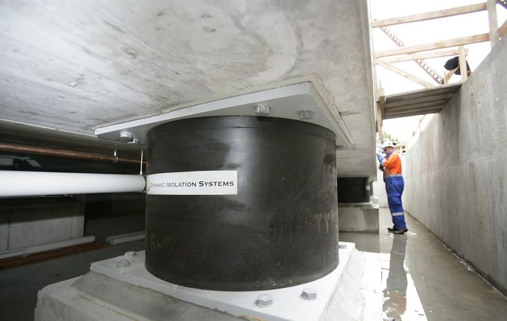 Base isolator for earthquakes