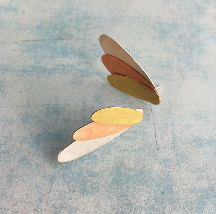 Angel wings  Excited to share the latest addition to my #etsy shop: Sterling silver,copper and brass earrings  stud earrings -leaf shape -oval shape-contemporary jewellery -boho jewelry-mix 3 metals -feathers #jewelry #earrings #silver #gold #minimalist