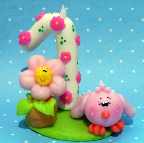 Topo de bolo tema Jardim encantado florido esculpido a mão em biscuit.  Mudamos o numero e cores caso desejado! R$ 18,99