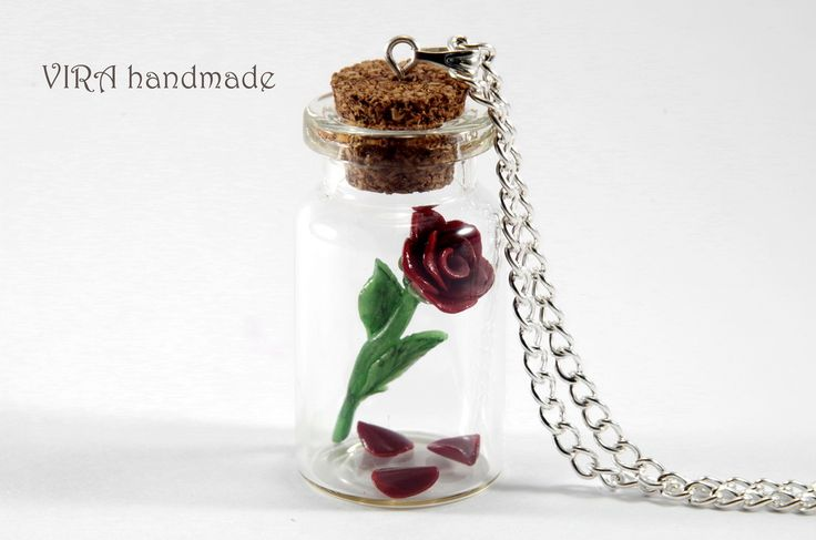 Rose with fallen petals in a glass jar
